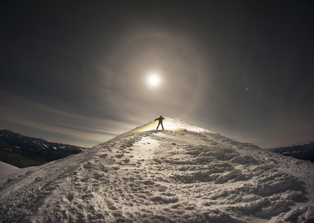 very mysterious and fantastic full moon snow space of high mountains Ukraine- Ukrainian Carpathians, carved by the winds, blizzards, storms and snowfall in decorative patterns and figures Stock Photo
