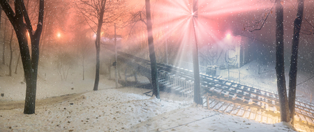 sobor: Funicular from hem to St. Michaels sobor- evening night shot during a snowfall fog, among the trees of the old capital of the park during the illuminations before Christmas and New Year Stock Photo