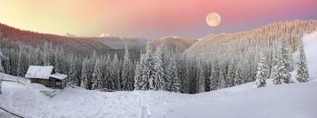 Snow-covered slopes of the Ukrainian Carpathians in the afternoon, and at sunrise and sunset is beautiful and attractive. Slender fir and lush beech shackled by frost and rime, houses decorated with views of the Shepherds Editorial