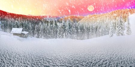 Snow-covered slopes of the Ukrainian Carpathians in the afternoon, and at sunrise and sunset is beautiful and attractive. Slender fir and lush beech shackled by frost and rime, houses decorated with views of the Shepherds Stock Photo
