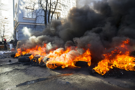disperse: Riots in the city, citizens in conflict with the power harness tires and vehicles police disperse demonstrators in Europe, protesting people fighting for their rights, is also breaking the law