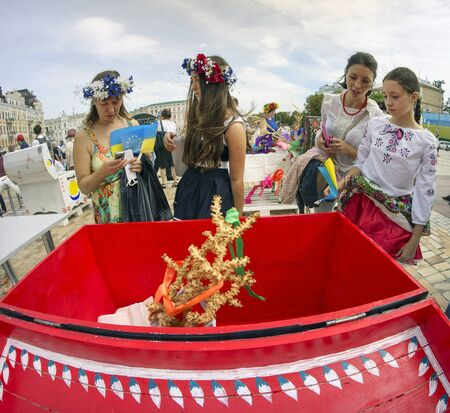 Kyiv; Ukraine-August 24; 2014: After the military parade on Khreschatyk in honor of Independence Day people in national embroidered shirts gathered at St. Sophias Square; on the feast of wedding ceremonies