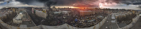 outcry: Kiev, Ukraine - February 20, 2014: Panoramic view from the roof of the House of Trade Unions previously burnt when police loyal to Yanukovych, backed with the Maidan and protesters began to restore order