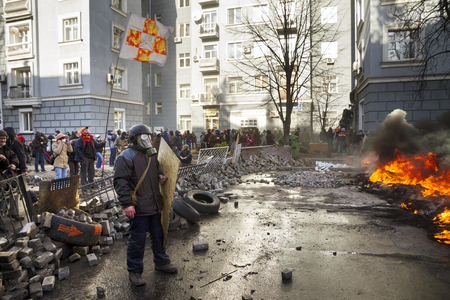 Ukraine, Kiev, 18 February 2014: Riots in the city, citizens in conflict with the power harness tires and vehicles police disperse demonstrators in Europe, protesting people fighting for their rights