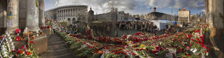 Kiev, Ukraine - February 24, 2014: Freed from government troops Evromaydan. Residents of the city bring flowers and light candles in memory of the fallen defenders of the capital