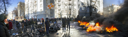disperse: Ukraine, Kiev, 18 February 2014: Riots in the city, citizens in conflict with the power harness tires and vehicles police disperse demonstrators in Europe, protesting people fighting for their rights