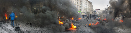 barricades: Kiev, Ukraine - January 20, 2014: The barricades on the street were built Hrushevskoho defenders of democracy to stop the advance of the special forces remained loyal to President Yanukovych-squad Berkut Editorial