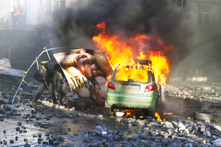 Ukraine, Kiev, February 18, 2014: Riots in the city, citizens in conflict with the power harness tires and vehicles police disperse demonstrators in Europe, protesting people fighting for their rights