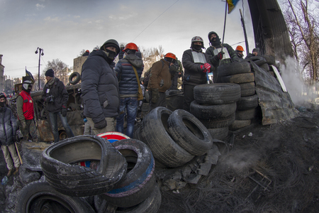 both sides: Kiev, Ukraine - January 27, 2014: Temporary truce after-death battles and demonstrators lull, both sides are in their positions, while preparing for the possibility to take the offensive.