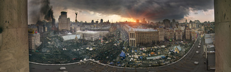 previously: Kiev, Ukraine - February 20, 2014: Panoramic view from the roof of the House of Trade Unions previously burnt when police loyal to Yanukovych, backed with the Maidan and protesters began to restore order