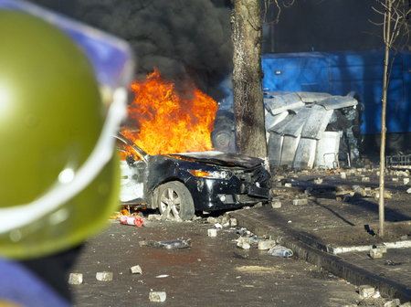 law breaking: Riots in the city, citizens in conflict with the power harness tires and vehicles police disperse demonstrators in Europe, protesting people fighting for their rights, is also breaking the law