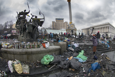 Kiev, Ukraine - February 20, 2014: Freed from government troops Evromaydan. The smoke protesters hiding from snipers, collecting stones and bottles at the devastated area to the forward position