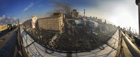protesters: Kiev, Ukraine - February 20, 2014: Panoramic view from the roof of the House of Trade Unions previously burnt when police loyal to Yanukovych, backed with the Maidan and protesters began to restore order