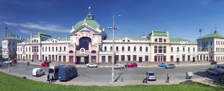 chernivtsi: Chernivtsi, Ukraine - April 27, 2014:Chernovtsy- famous and popular station - A symbol of tourism, there are many old buildings, old cars and the area, walking pedestrians are on their business among the warm spring sun