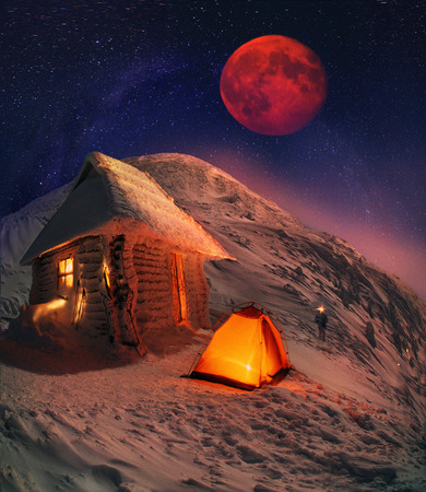 reigns: Incredible Moon over Mount Goverla is a climbers dream, that dream of him again and again. Snowy storm has passed, now reigns at the top of the light, the silence and the cold. Alpine hut at an altitude of over 1,800 meters gives shelter to those seeking Stock Photo