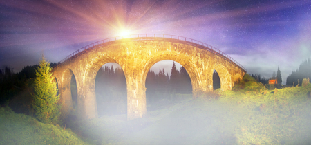 vertices: The beauty and charm of the historical panorama of the bridge in the Carpathian region - it is fantastic facilities architect a century antiques on a background of beautiful pure vertices, a favorite of tourists and travelers Stock Photo