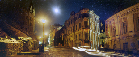 Kiev, Ukraine - December 9, 2008: The famous St. Andrews descent, street-symbol of the capital. So it was before the renovation. Winter evening, dark, the townspeople have gone home, leaving the machine Redakční