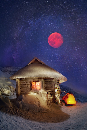 concealing: Tents and shelter Located on the slopes of the highest mountain of Ukraine Hoverla. Night winter ascent on the Montenegrin ridge-captivating and dangerous, concealing the romance and fantasy, a real Klondike for the landscape photographer. Moonrise hypnot Stock Photo