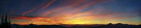affects: Alpine sunset in the Carpathians affects its brilliance and predicts the coming of a rough day with the wind and rain. On the background painted last rays of the sun-lit vertices blaze clouds