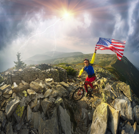 American racer autumn marathon route passes the tourist route in the wild mountains and fortified trenches dug the First World War with the United States flag United States of America