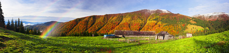 Ukrainian Mountain West Ukraine is famous for its wildlife and the natural economy of shepherds herding sheep in the high mountain pastures in the summer. The rest of the house deserted. The first snow fell.