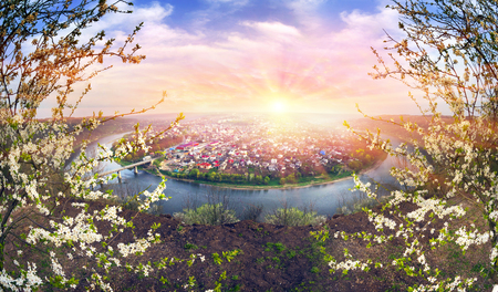 Zaleshiki town on the bank of the Dniester River on the scenic bend of the spring, when the bloom in the gardens of cherry plum trees apple apricots. Reminiscent of the canyon in Colorado, USA