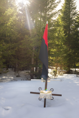 Ukraine, Verkhovyna - April 3, 2016: Grave Ukrainian Bandera rebel UPA monument of World War II who died in a battle with Soviet red communist death squads of the NKVD of the USSR