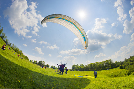 top 7: Ukraine, Odaiv - June 7, 2015: At the top of the river starting point for beautiful sport bold pilots - flying on small aircraft in the updraft in cumulus clouds in a bright sunny day in a good tail wind Editorial