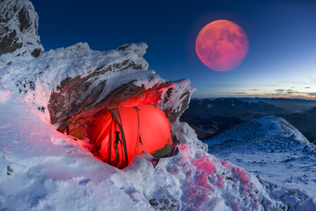 Winter Smotrych on top of the Carpathians - the chimera fairy rocks under the starry sky. Hikers pass this mountain on the way to the Black Mount Pip Ivan Chernogorsky in the modern tent