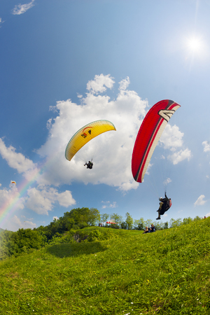 top 7: Ukraine, Odaiv - June 7, 2015: At the top of the river starting point for beautiful sport bold pilots flying on small aircraft in the updraft in cumulus clouds in a bright sunny day in a good tail wind Editorial