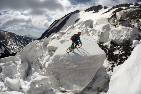 powerful avalanche danger in the rural Carpathian Ukraine, which is pulled down a slope of Black Mountain. dangerous for tourists travelers climbers, athlete performs a trick on the avalanche