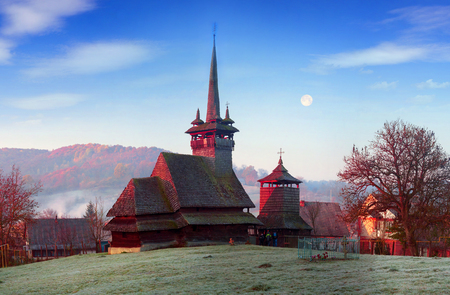 Unique 17th century wooden churches in Transcarpathia, Ukraine-churches with tall towers and slender spiers, in county Marmarosh- wooden gothic, oak, in history-Orthodox and Catholic Stock Photo