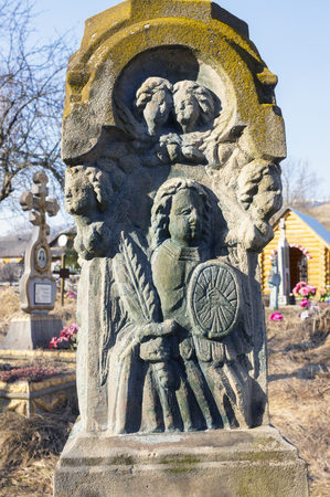 The old village cemetery near the church in the mountains has interesting ancient monuments of Christian culture beautiful art naive believers Carpathian Ukraine Eastern Europe