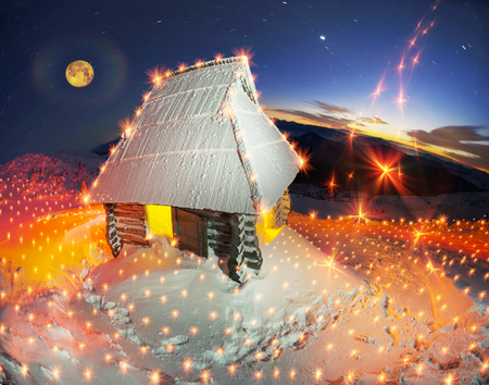 yule log: At the highest peak of Ukraine Goverla is a shelter hut happy romantic Ukrainian country. Buried in snow asylum withstand bad weather and wind storms frost Chernogora