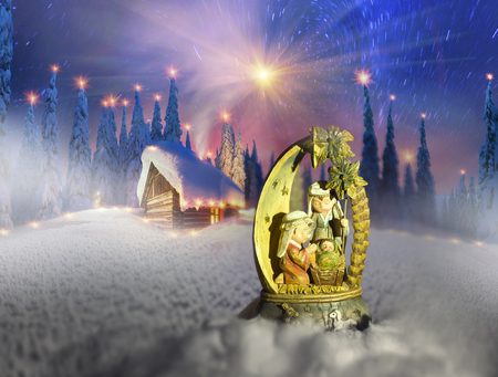 The sacred ancient religious sculpture on a Christmas theme background winter mountain landscape in Ukraine Carpathian spruce tops and cold wilderness of Eastern Europe Stock Photo