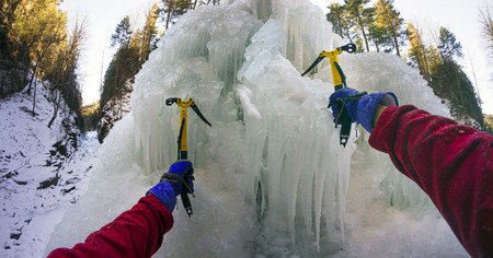 requires: Icefall - alpinists, climbers, ascenders, hikers are training it to rise on the big mountains. Extreme sport requires courage, experience and equipment for mining safety and success climber