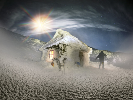 Chernogora dressed in a blanket of snow and ice, alpine panorama at night with the moon look fantastic for the lone climber about icy shelter and terribly lonely ice Goverla mystical moon at sunrise Stock Photo