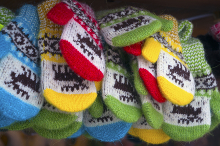 Christmas Christmas collection of beautiful soft comfortable warm mittens with pattern designs in Lviv offers tourists and travelers the guests of the city citizens on the Market Square