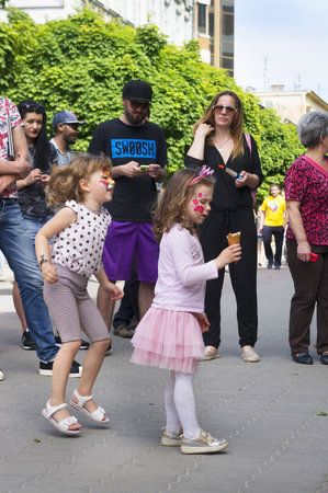 Ukraine, Ivano-Frankivsk, May 20, 2017: Concert on the festival of music painted with drawings on the face of dancing children and teenagers amidst the cheerful spectators of Eastern Europe Editorial