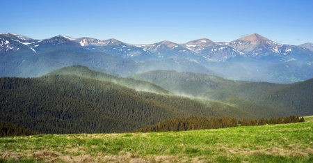 Montenegrin ridge, Goverla smoke light yellow pollen of fir trees and pines hanging in air vortices in the air in the early spring on the Kostrych between Verkhovyna and Vorokhta Ukraine