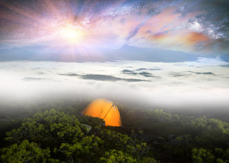 tent city: Panorama of the night mountains from the peak of Synyak in the Gorgan Mountains above Bukovel resort. The sea of fog in the valley against the background of high peaks in the moonlight