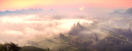 carpathians: A gentle morning in the Carpathians, Ukraine. Wet waves of fog cover the mountain village of Transcarpathia against the background of the blue crests of ridges and peaks, wild forests