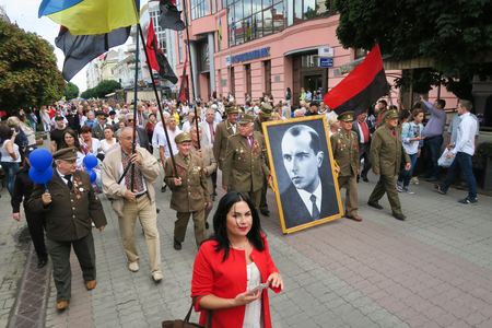 24 month old: Ukraine, Ivano-Frankivsk - August 24, 2017: Independence Day is a state holiday of a sovereign European country. UPA veterans and Bandera portrait of Stepan Bandera ideologue nationalism