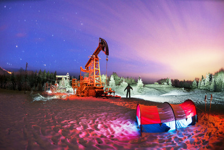 Day and night, in a severe frost and a snowstorm, a snowstorm in winter in Ukraine electric mountain pumps oil pump oil gas is a valuable raw material for energy 