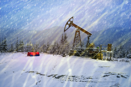 Day and night, in a severe frost and a snowstorm, a snowstorm in winter in Ukraine electric mountain pumps oil pump oil gas is a valuable raw material for energy   chemical industry