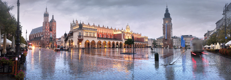 Market Square with the famous tourists of the architecture of Eastern Europe and the sights of the ancient city. Krakow Autumn with a cold rain in the center before the beginning of winter Editorial