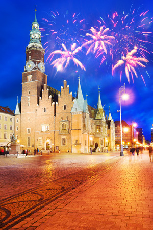 The center of the beautiful old city of Wroclaw with festive illuminations after sunset. Unique europe Christian and residential architecture attracts many tourists tourists
