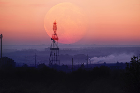 oil rig at night on the moonrise in Ivano-Frankivsk on the outskirts of the city explored the reserves of a valuable deposit of Ukrainian oil and gas for the countrys energy independence
