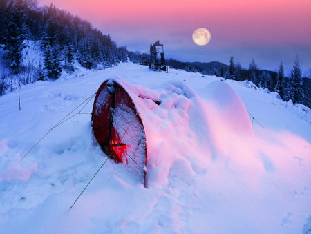 powerful cyclone brought dangerous snowfalls snowstorms to the mountains during the mountain hike of tourists in the Carpathians, Ukraine. Alpine climate is famous for its bad weather