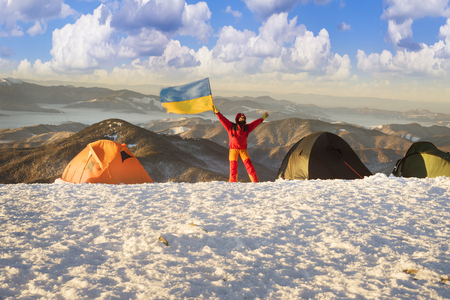 At the highest peak of Ukraine Goverla stands on New Year camp climbers romantic Ukrainian country. Extreme tent buried in snow storms withstand bad weather and frost wind Chernogora
